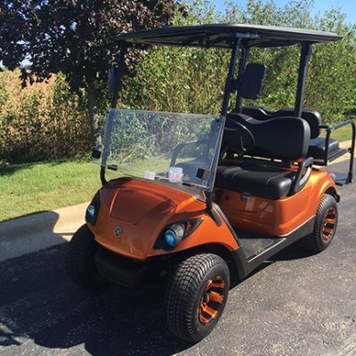 orange and black 4-passenger drive-Harris Golf Cars- Iowa, Illinois, Wisconsin, Nebraska
