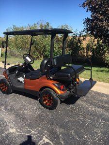 orange and black 4-passenger drive-Harris Golf Cars- Iowa, Illinois, Wisconsin, Nebraska